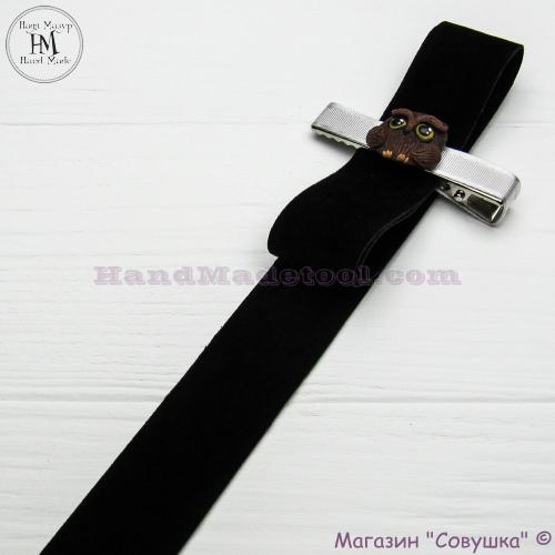Faux suede ribbon 2,5 cm width, colour 60-black.
